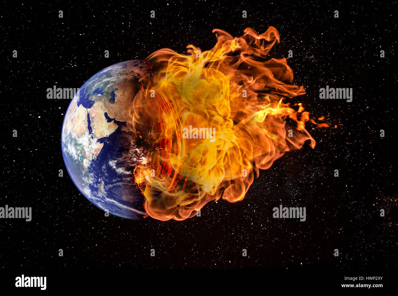 Planet earth in outer space engulfed in flames. Concept of natural disasters, global warming, apocalypse, war, judgment - Stock Image