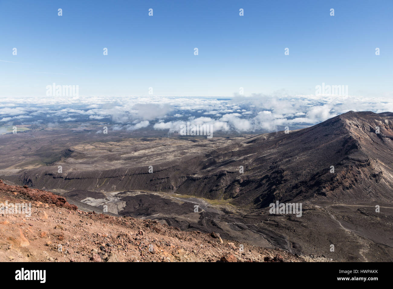 The famous Tongariro Alpine crossing hiking rail viewed from the slope of the Ngauruhoe volcano in New Zealand north - Stock Image