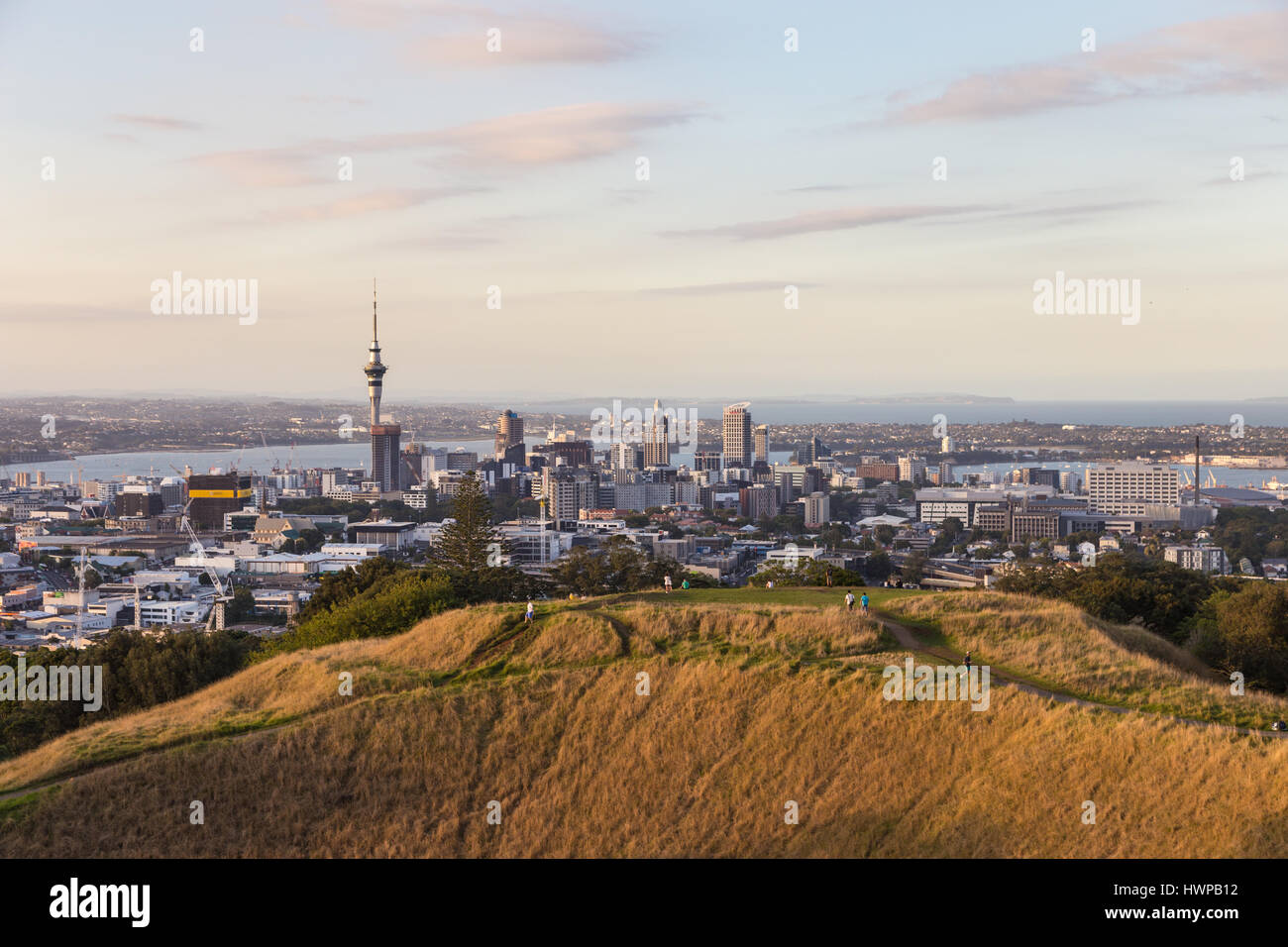 Sunset over Auckland business district from the Mount Eden in New Zealand largest city. The volcano crater is in - Stock Image