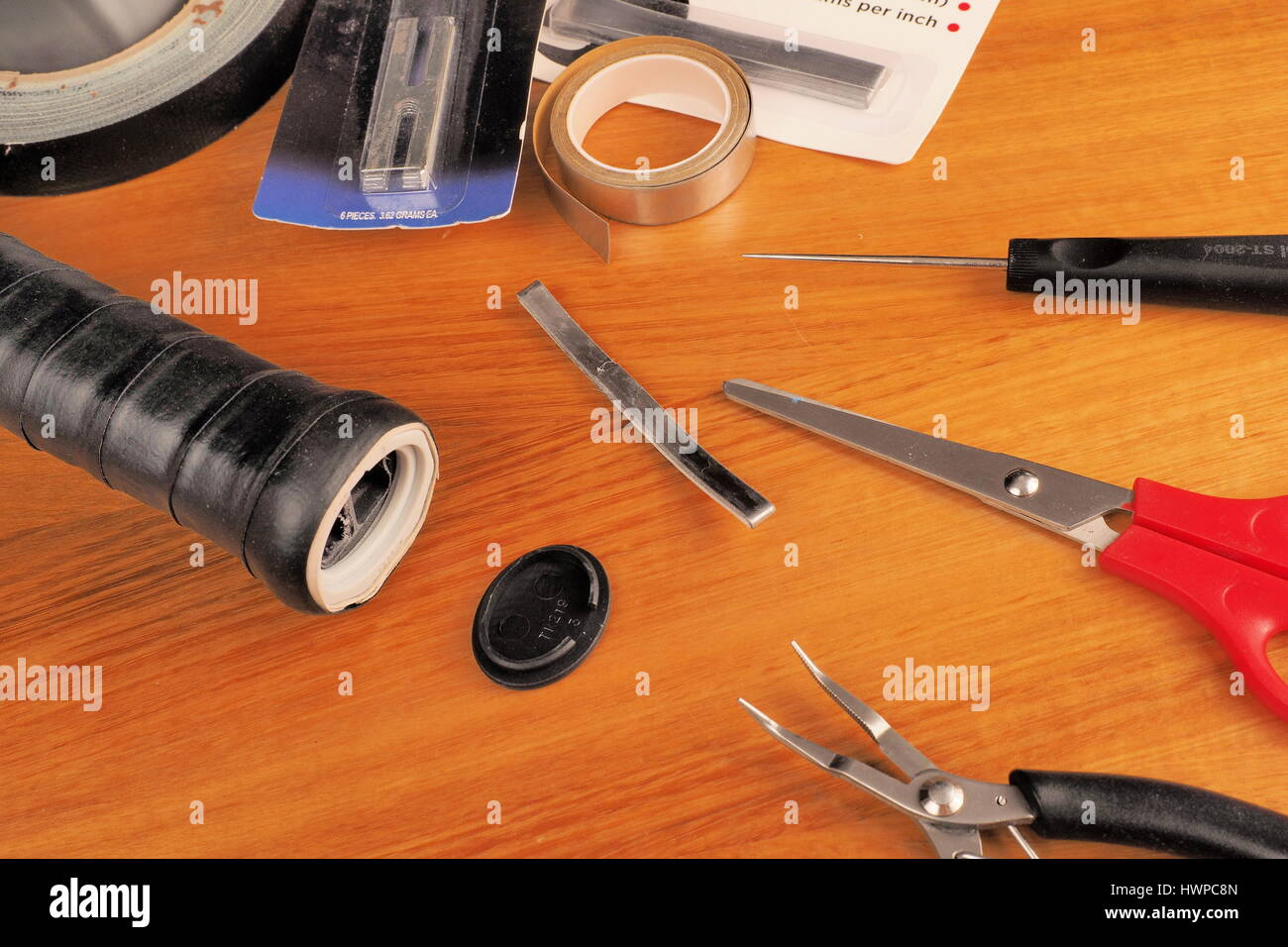 Melbourne, Australia, 2015, May 9: Tennis racquet handle prepared for lead installation in the process of balancing - Stock Image