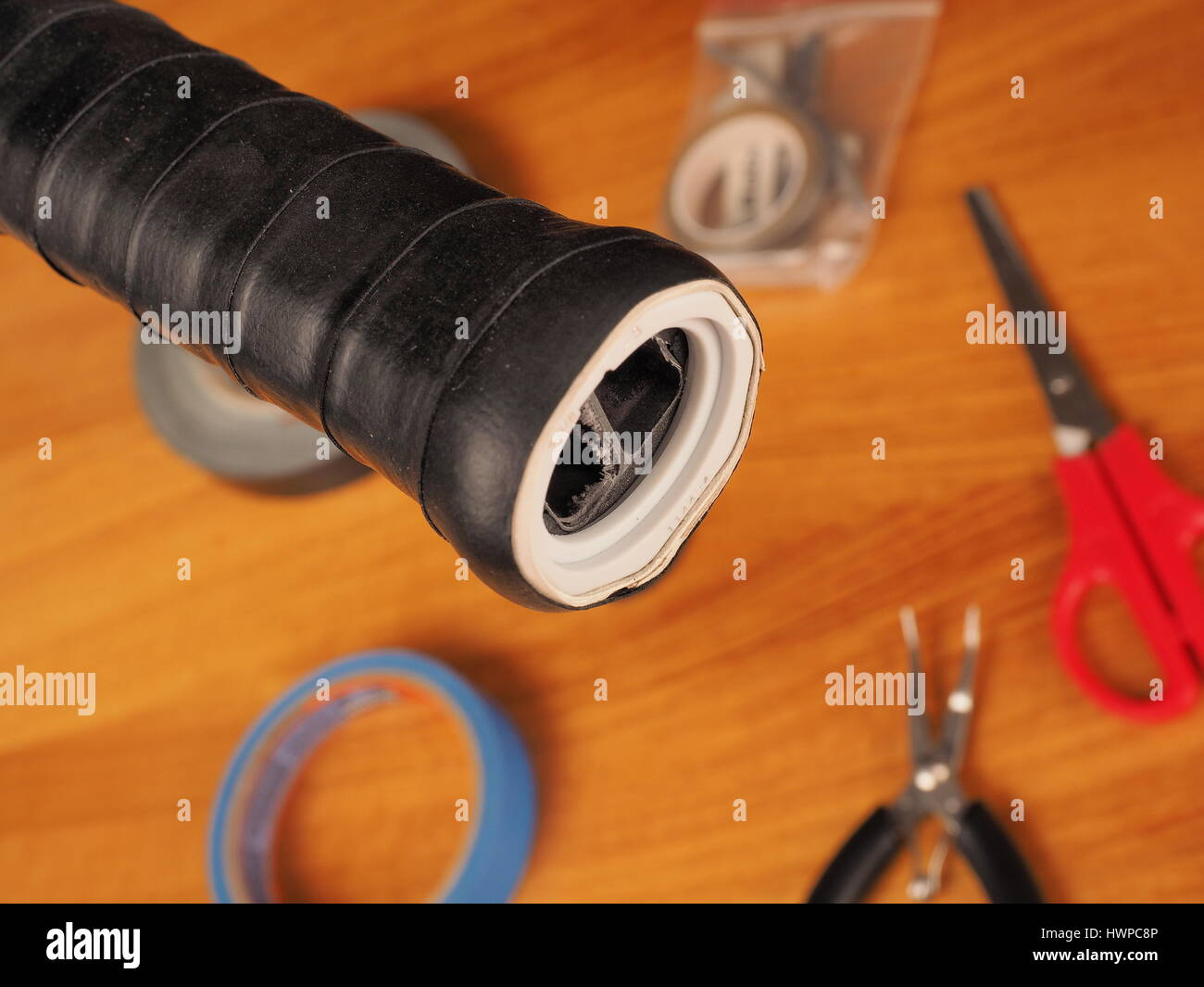 Melbourne, Australia, 2015, May 9: Tennis racquet handle close-up of the hollow inside through the opening after - Stock Image