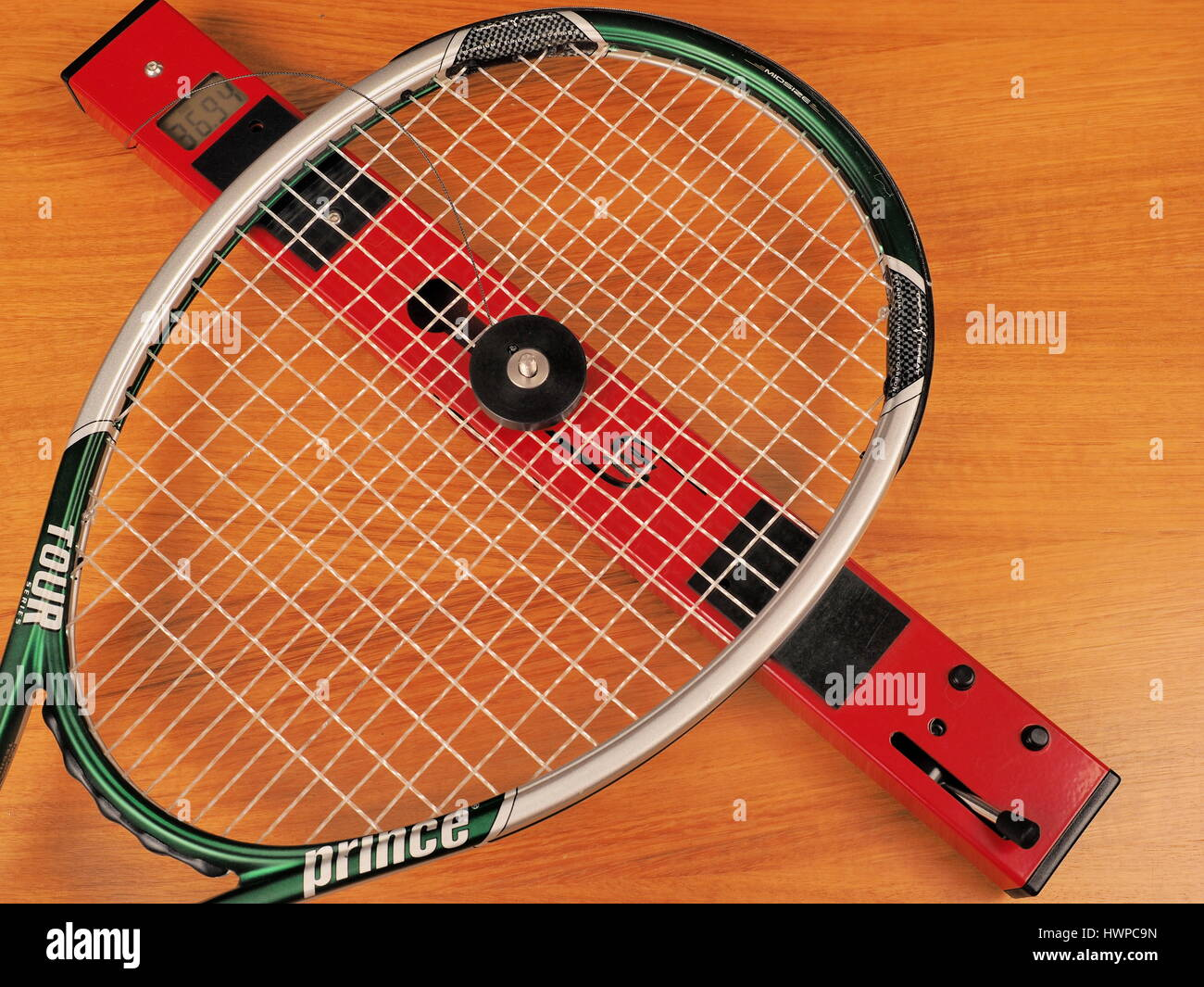 Melbourne, Australia, 2015, May 9: String bed stiffness of a Tennis tour player frame is measured on strings. The - Stock Image