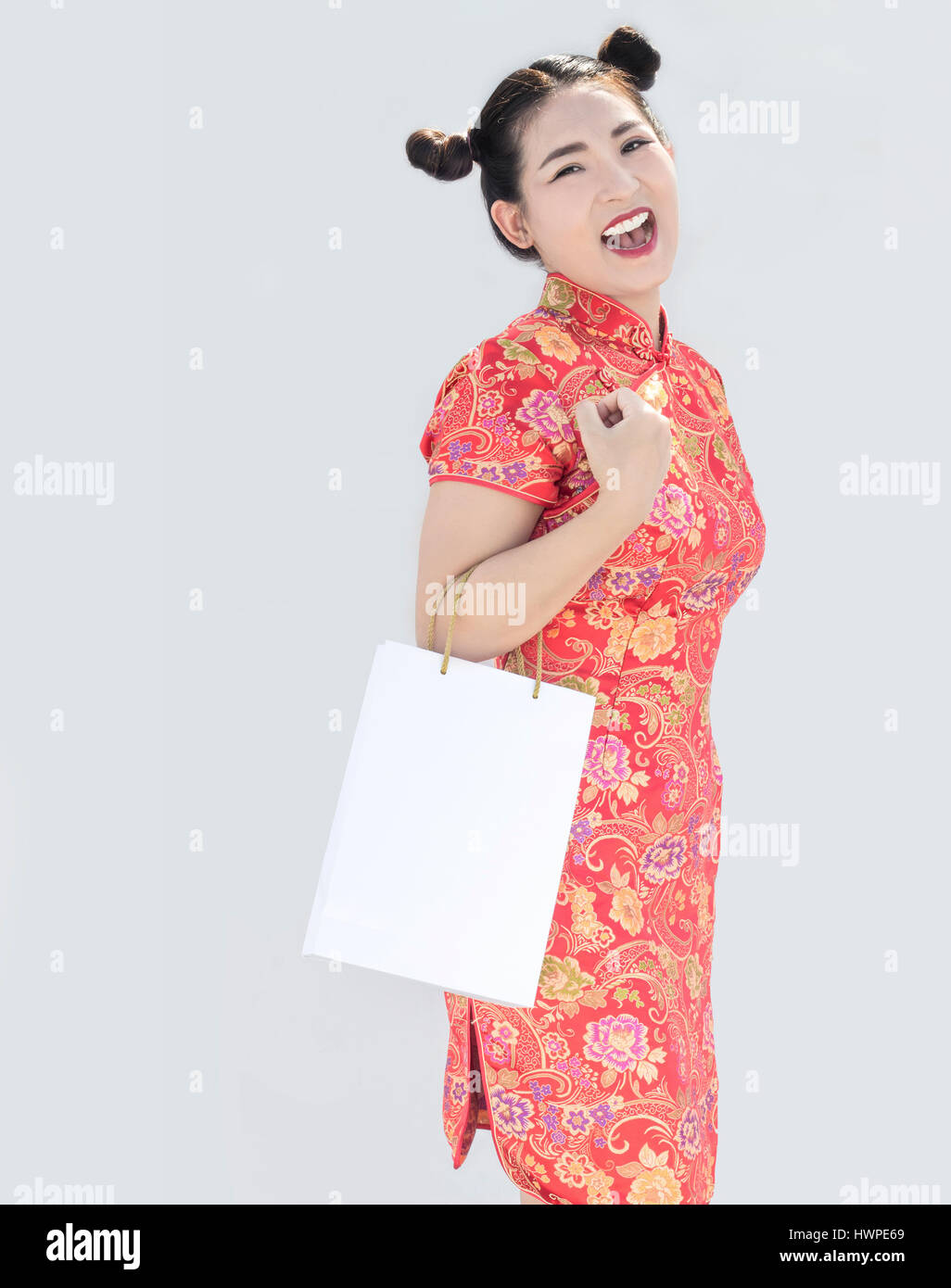 asian chinese girl with qipao dress hold shopping bag on background