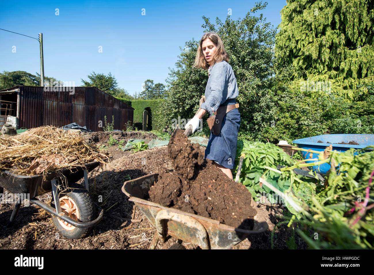 The Land Gardeners Henrietta Courtauld (pictured) and Bridget Elworthy making compost at Wardington Manor near Banbury, Stock Photo