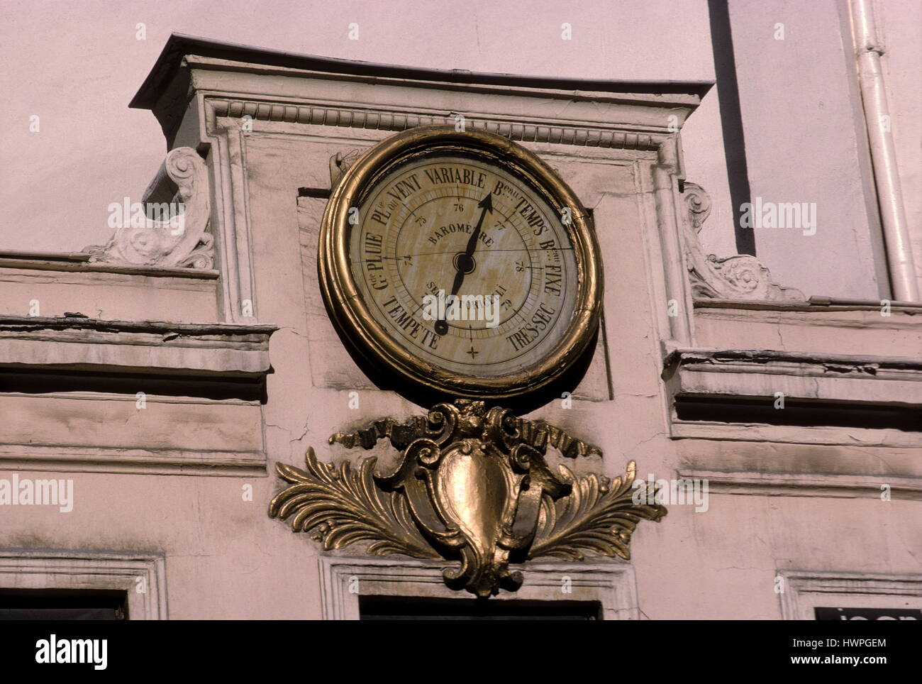 AJAXNETPHOTO. PARIS, FRANCE. - CHANGE IN THE WEATHER - LARGE ANEROID BAROMETER MOUNTED ON A BUILDING FACADE IN THE - Stock Image