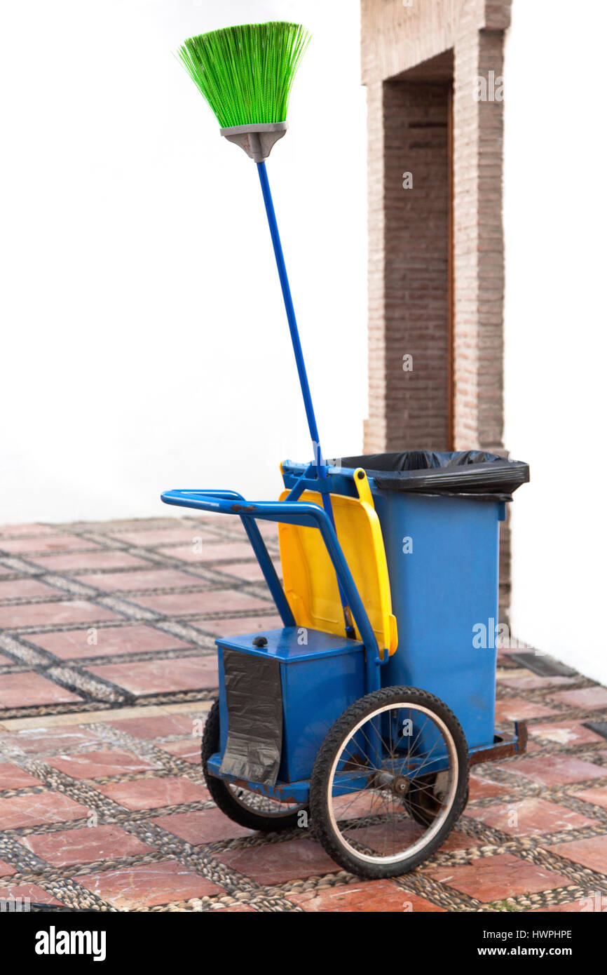 Street cleaner cleaning cart. - Stock Image