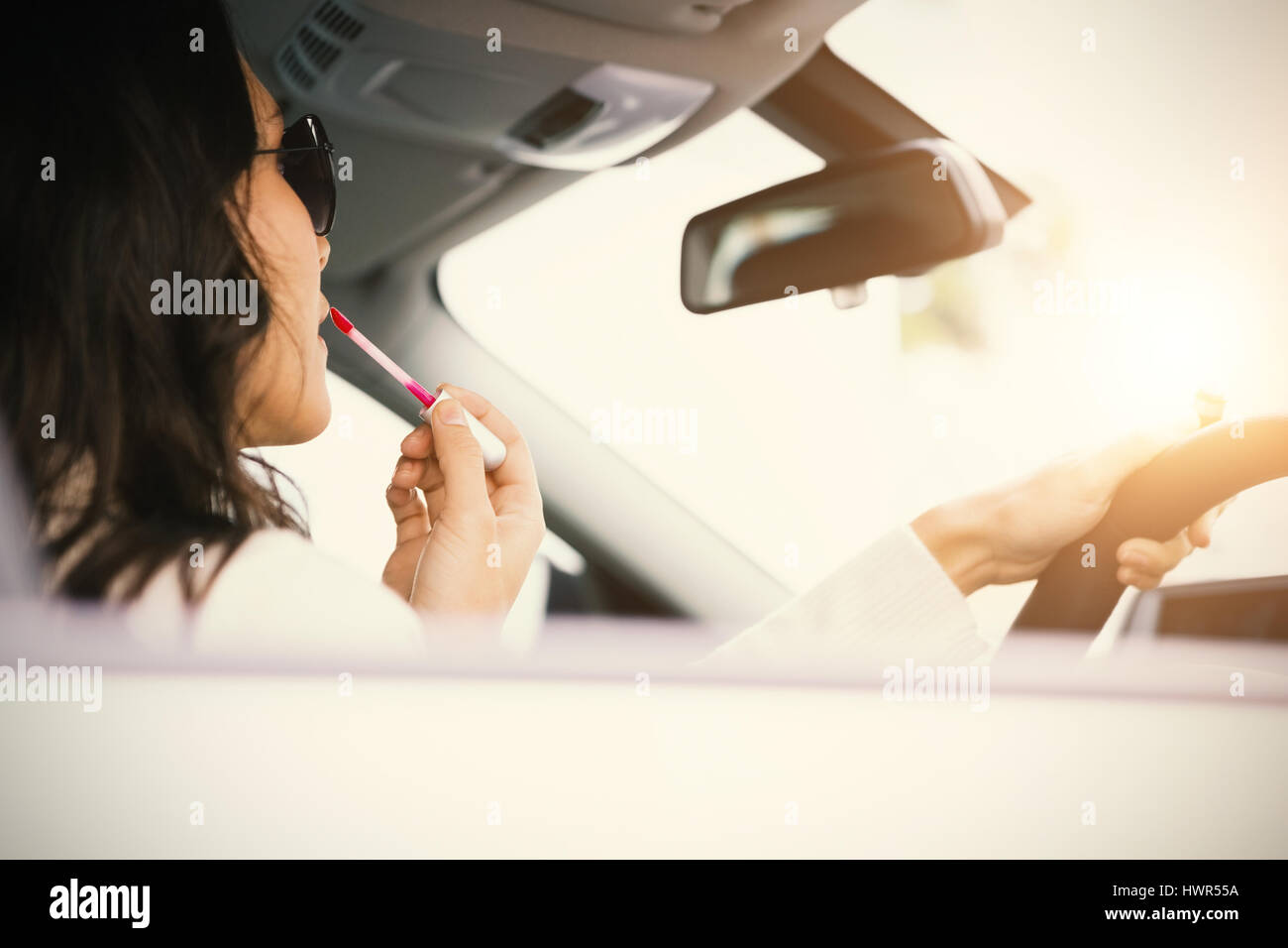 Woman driving a car - Stock Image