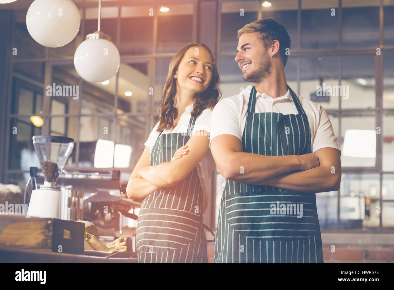 Graphic image of flare against smiling co-workers standing together - Stock Image