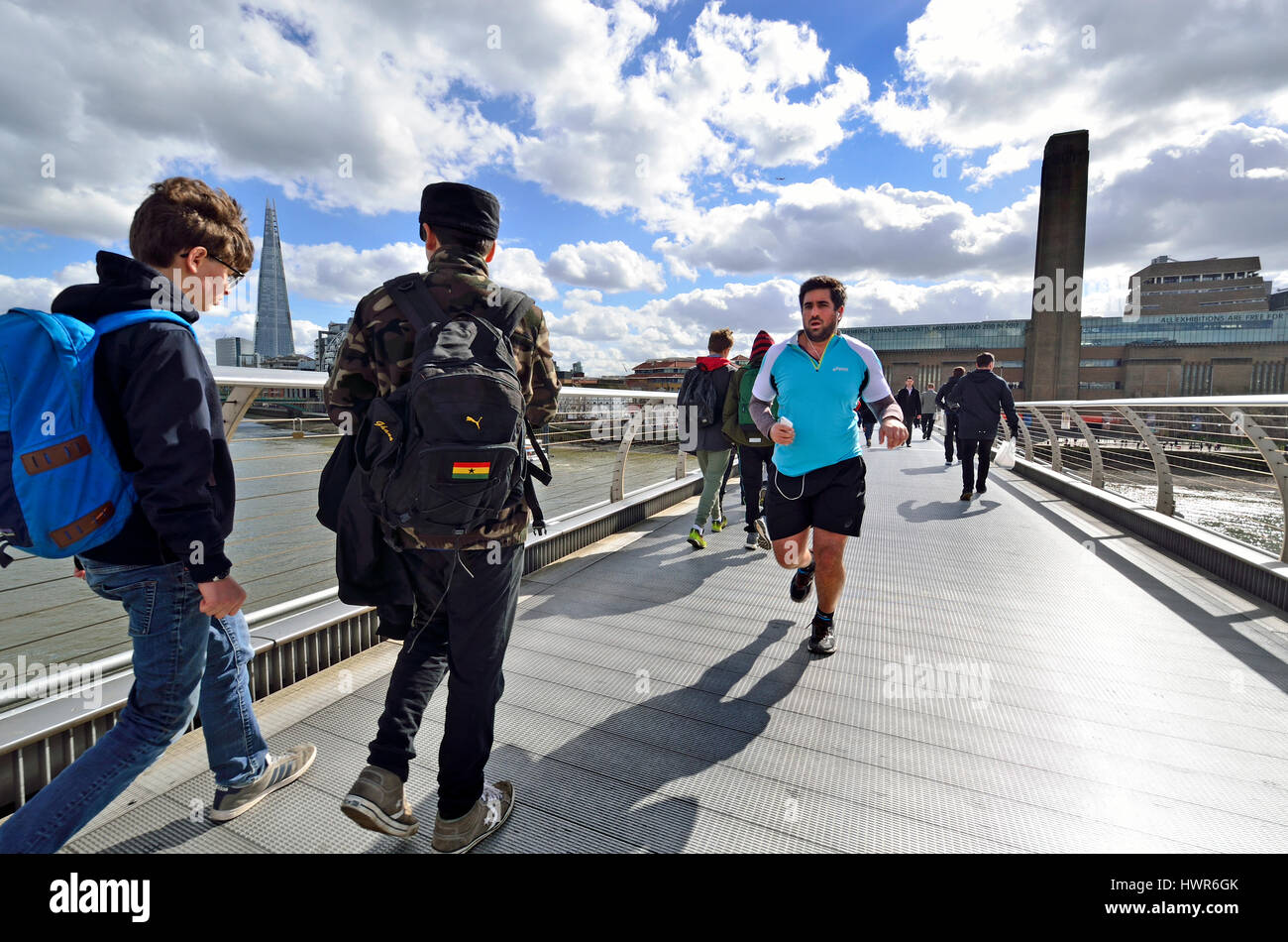 London, England, UK. Runners on the Millennium Bridge, running from Tate Modern northwards - Stock Image