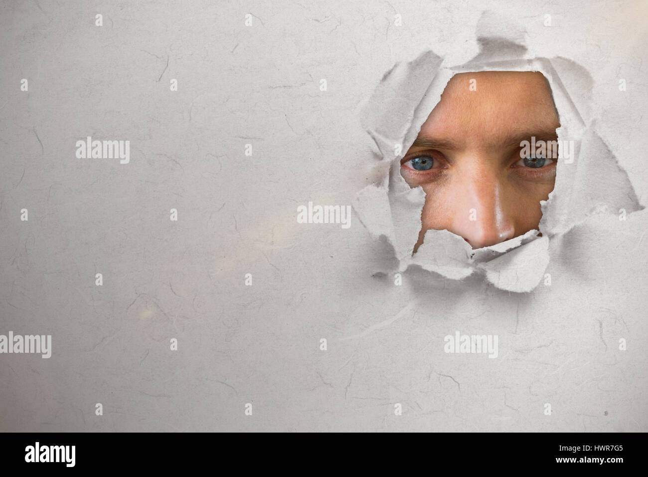 Portrait of sad man against circle hole in paper 3d - Stock Image