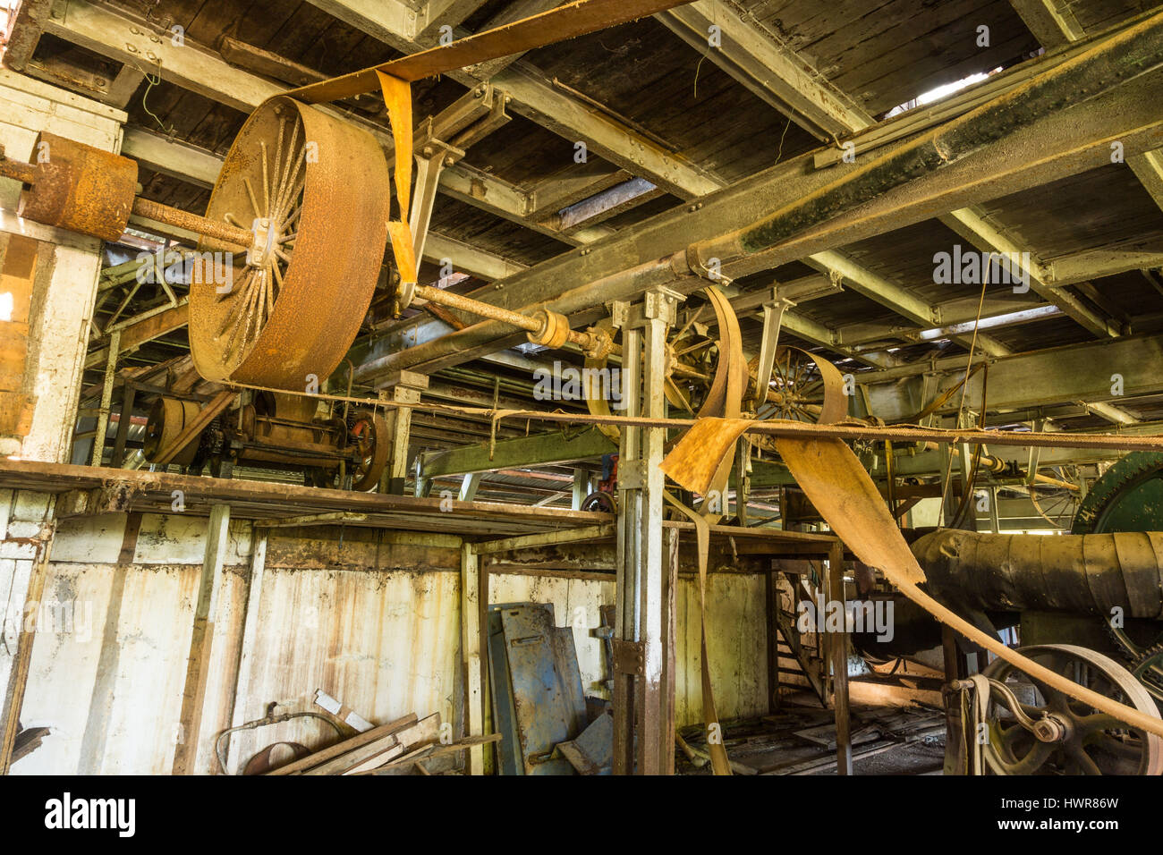 Old machinery in the abandoned coffee processing plant on the Pepperpot Plantation near Paramaribo, Suriname. - Stock Image