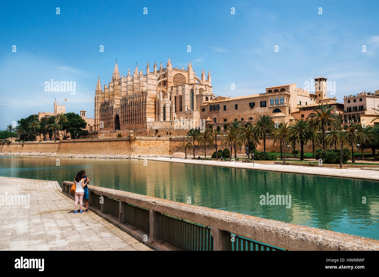 Palma de Mallorca, Spain - May 27, 2016: Park de la Mar against La Seu, the gothic medieval cathedral of Palma de - Stock Image