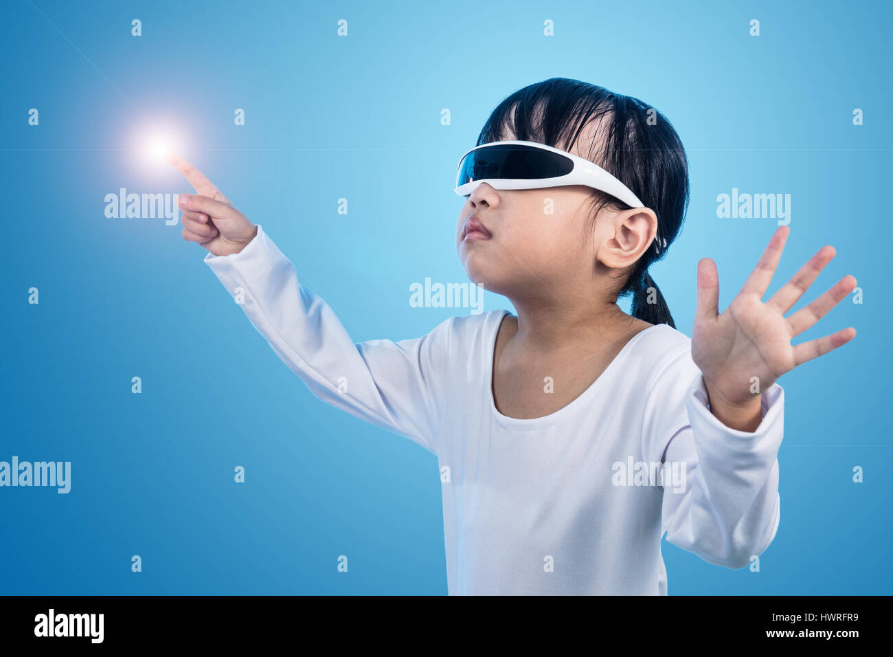 Asian Chinese little girl wearing futuristic eyeglassses and costumes act as cyborg in isolated background - Stock Image
