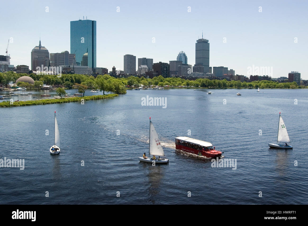 The Back Bay skyline and the Charles River from the Longfellow Bridge -   Community Boating Sailboats and a Duck Tour boat are in the foreground, Stock Photo