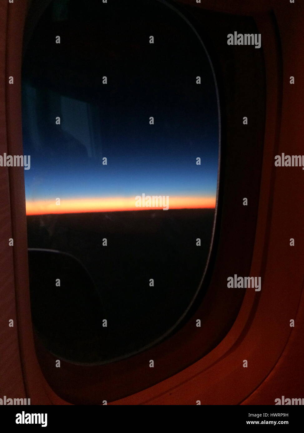 Colorful Sunset Horizon as seen from an airplane window - Stock Image