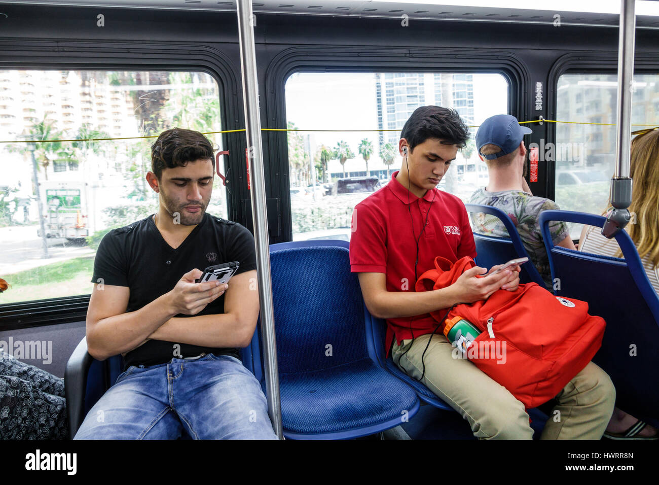 fe1c2d42470 Miami Beach Florida South Beach Local public transportation bus circulator  man boy teen young adult sitting