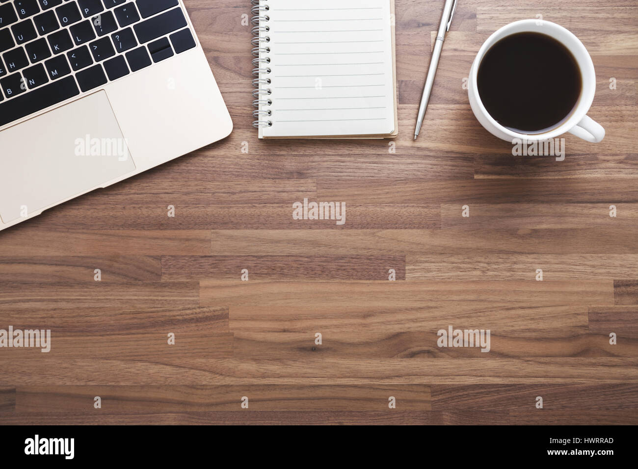 Office wood desk background with laptop and coffee cup