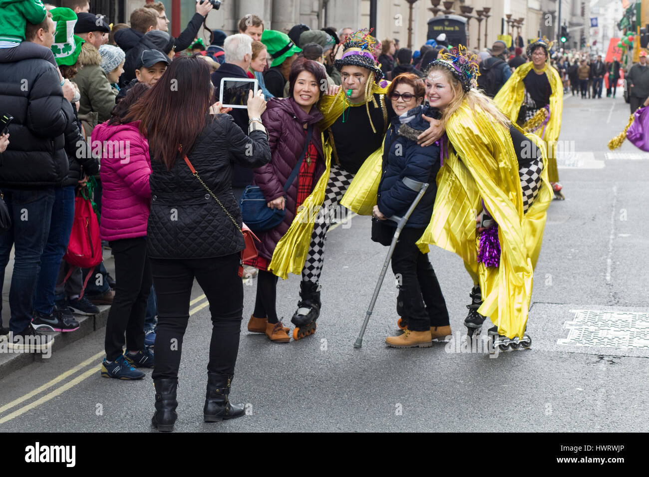Chinese tourists interrupting the Parade to take pictures - Stock Image