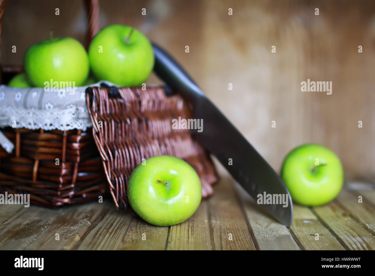 green apple in a basket - Stock Image