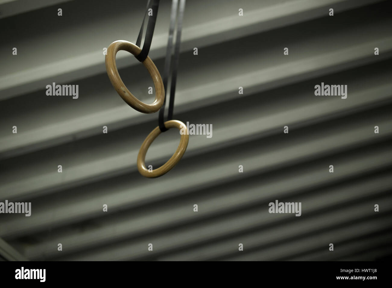 Low angle view of gymnastic rings hanging on ceiling - Stock Image