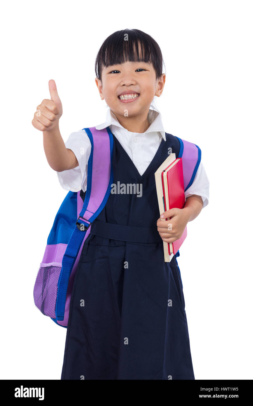 33037d40936 Asian Chinese little primary school girl with school uniform showing thumbs  up in isolated white background.
