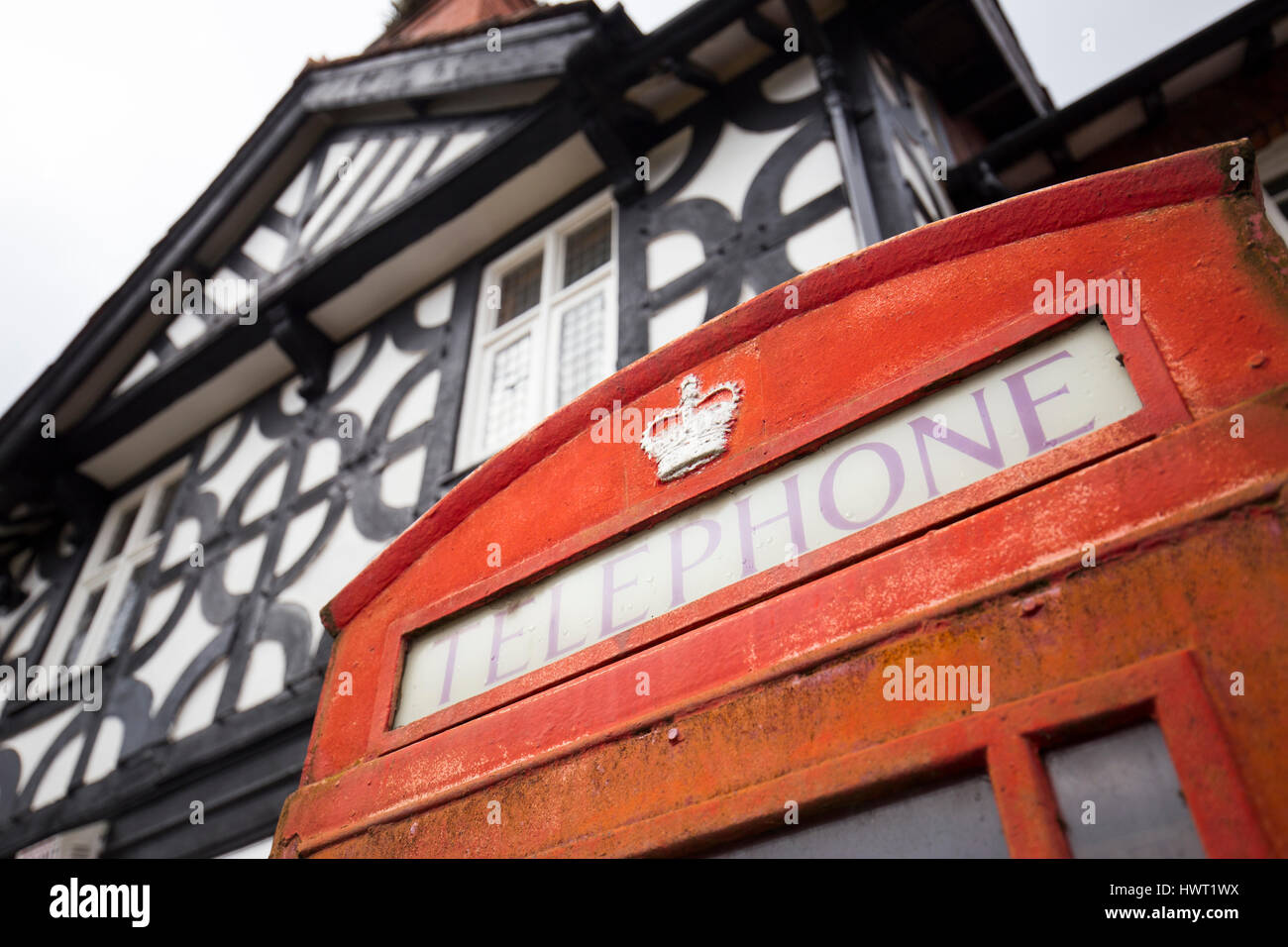 Port Sunlight - a model village and suburb in the Metropolitan Borough of Wirral, Merseyside. Traditional red phone - Stock Image