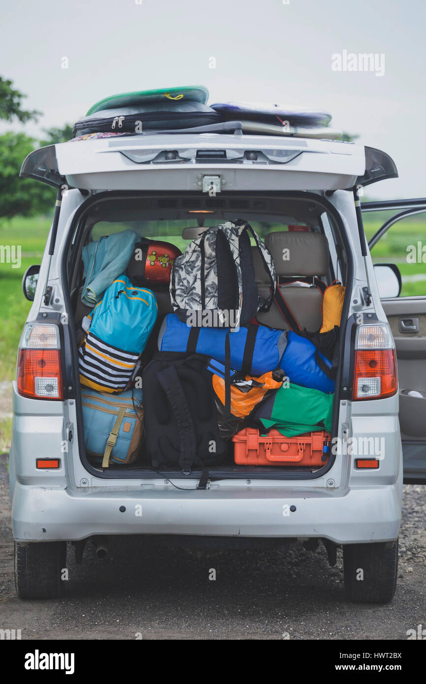 Backpacks loaded in car trunk - Stock Image