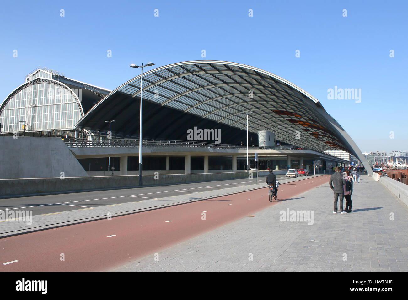 Cycling Lane near Amsterdam CS Central Station along IJ River, Amsterdam, Netherlands - Stock Image