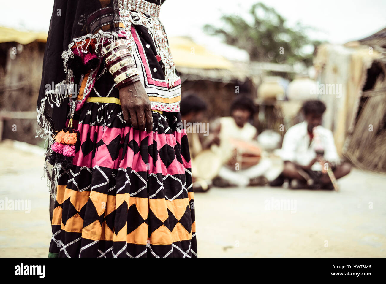 Midsection of woman in traditional clothing - Stock Image