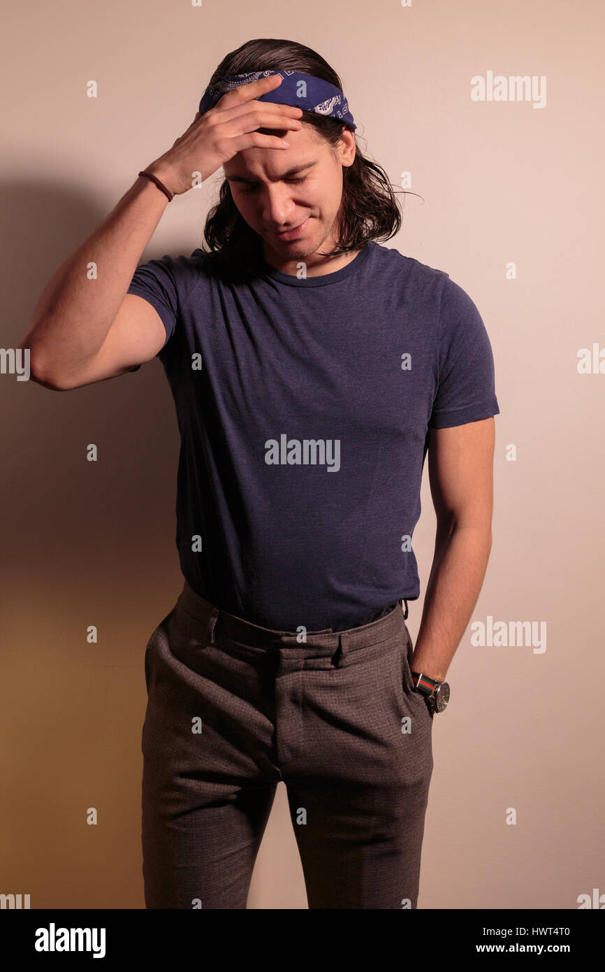 Young man rocker in bandana with long hair Stock Photo  136369632 ... 27e304466af
