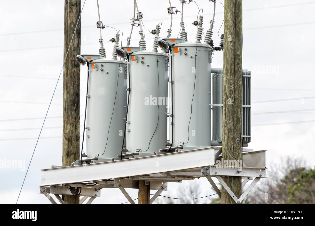 Three Electric Utility Transformers On Telephone Poles - Stock Image