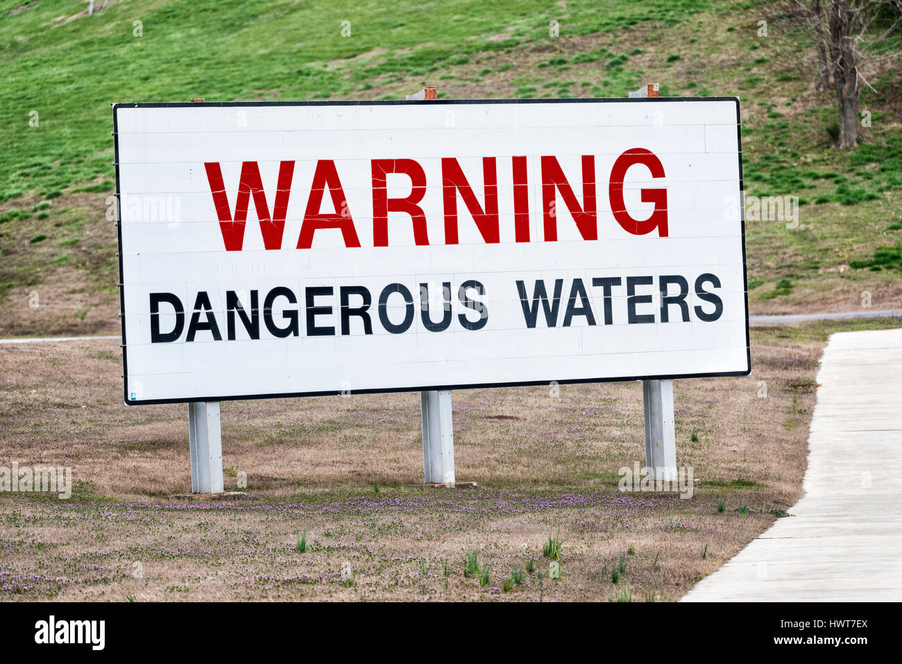 A big sign near a hydroelectric dam in Tennessee warns boaters, swimmers and others of the dangerous waters below. - Stock Image