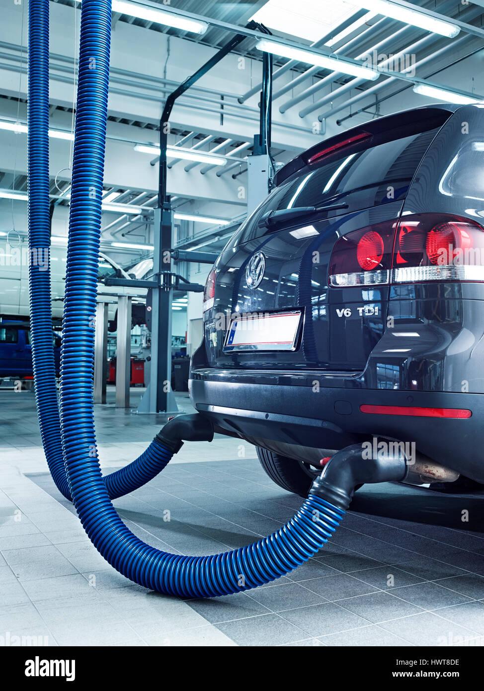 Exhaust emission measurement on car in a VW garage, Austria - Stock Image