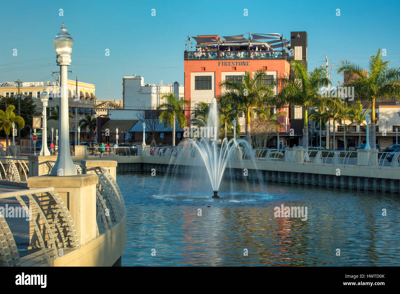 Harborside view of The Firestone Grille, Martini Bar & Sky Bar and buildings of downtown Ft Myers, Florida, - Stock Image