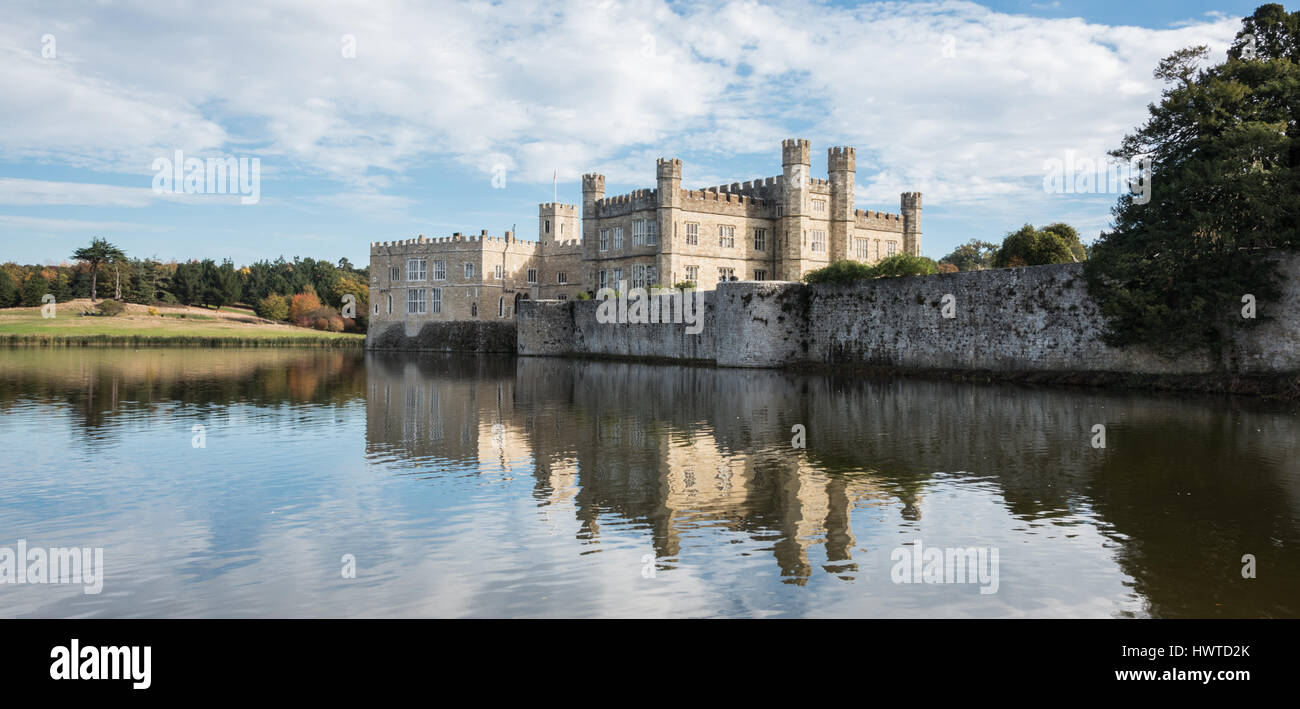 Leeds Castle, Kent, UK - Panorama of the castle and the grounds and its reflection on the water of the moat - Stock Image