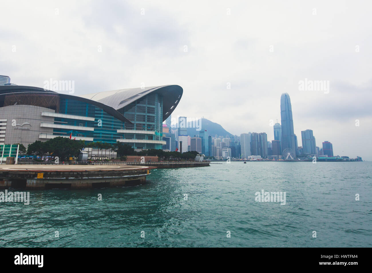 Beautiful super wide-angle summer aerial view View of Hong Kong island skyline, Victoria Bay harbor, with skyscrapers, - Stock Image