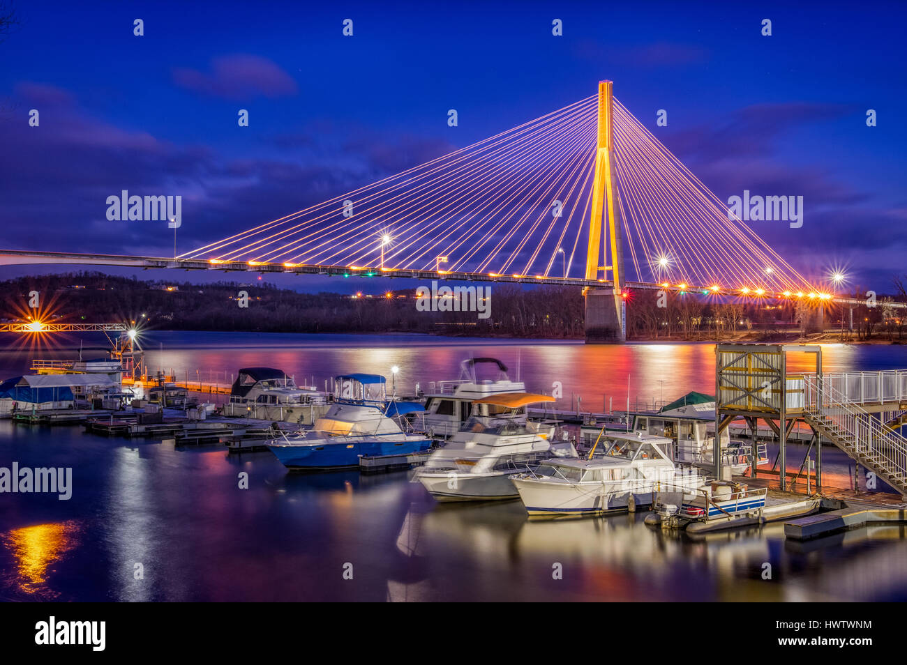 The suspension bridge spanning the Ohio River from Huntington, West Virginia at night. - Stock Image