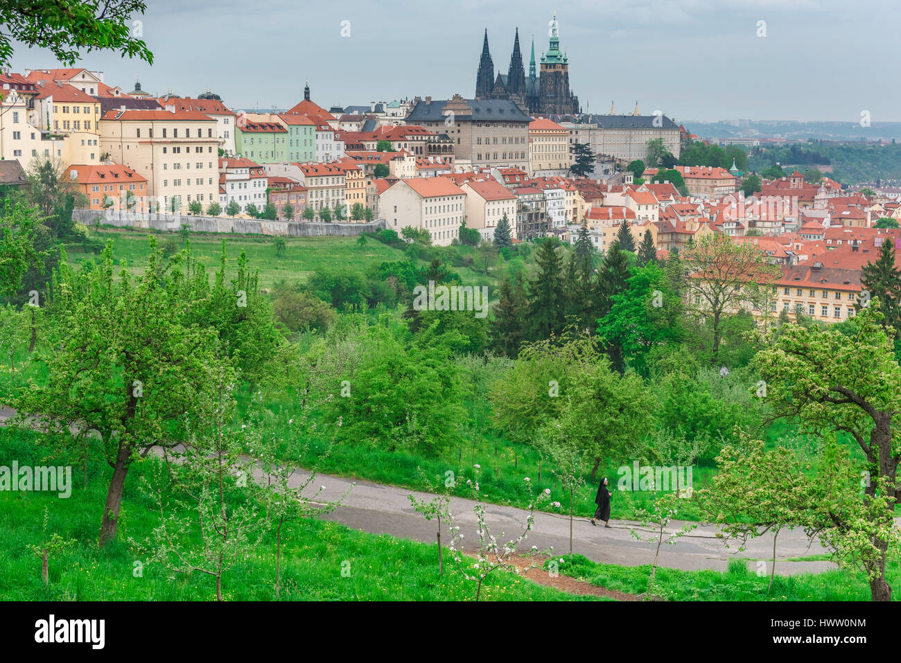 Petrin Hill Prague, on a late spring evening a nun takes a walk across Petrin Hill, a densely wooded park on the - Stock Image