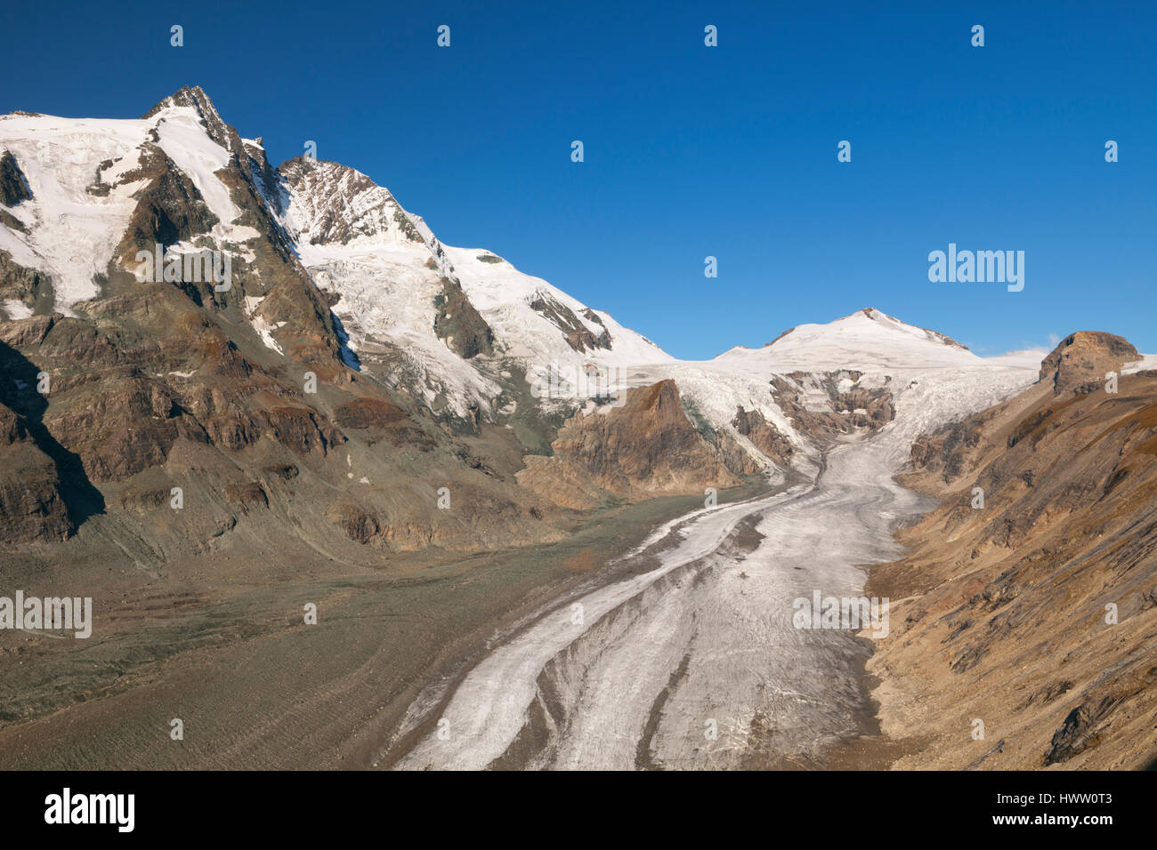 The Großglockner peak and Pasterze Glacier in the Hohe Tauern National Park in Austria on a clear day. Stock Photo