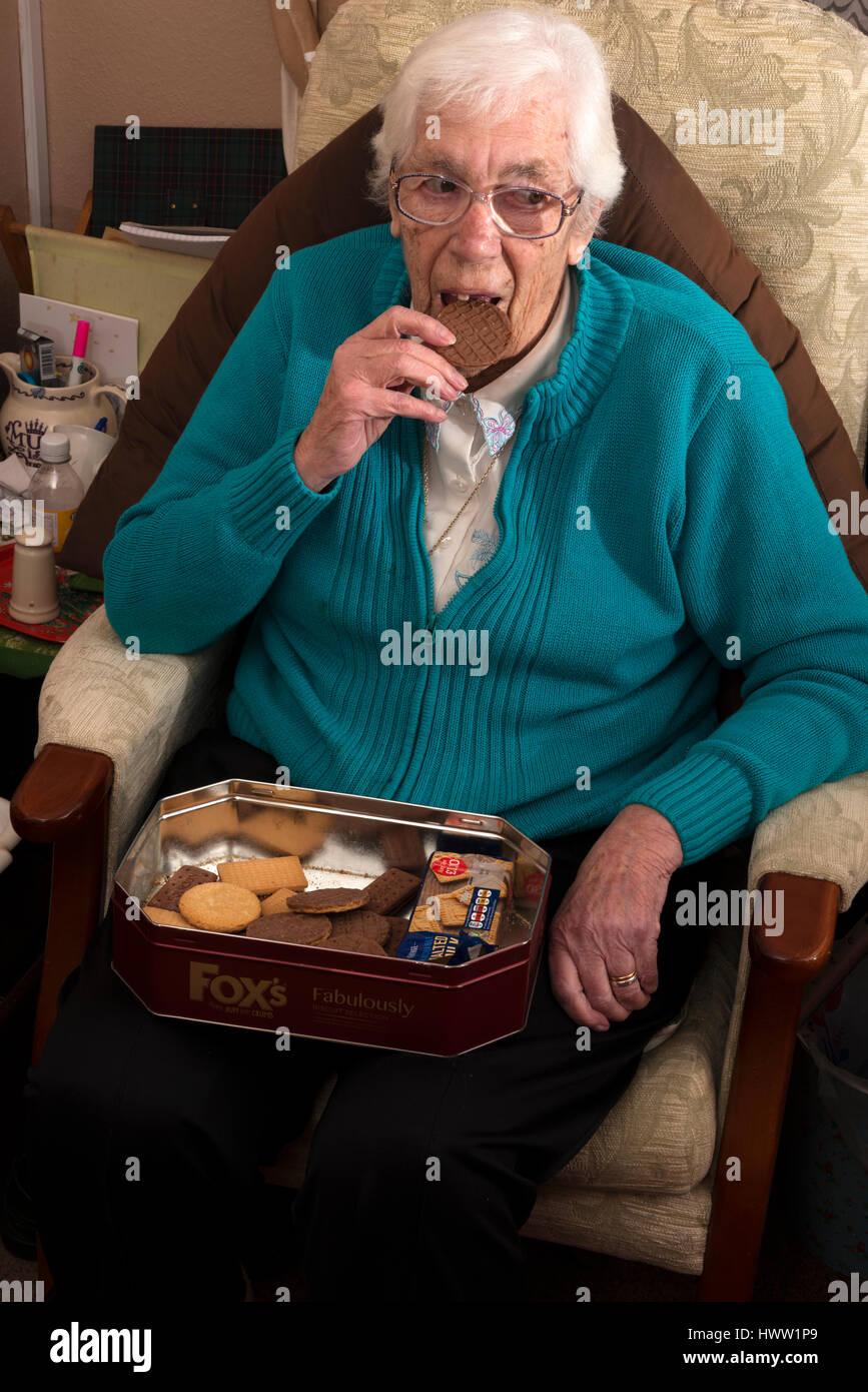 housebound-elderly-woman-eating-a-chocol