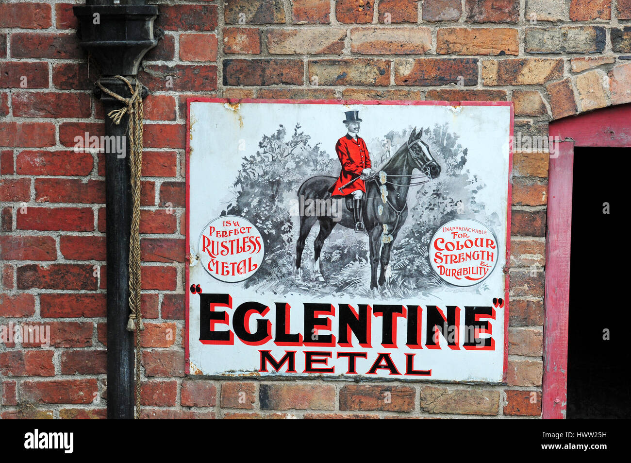 Enamelled metal advertisement on a brick wall.  Blists Hill victorian Village. Coalbrookdale - Stock Image