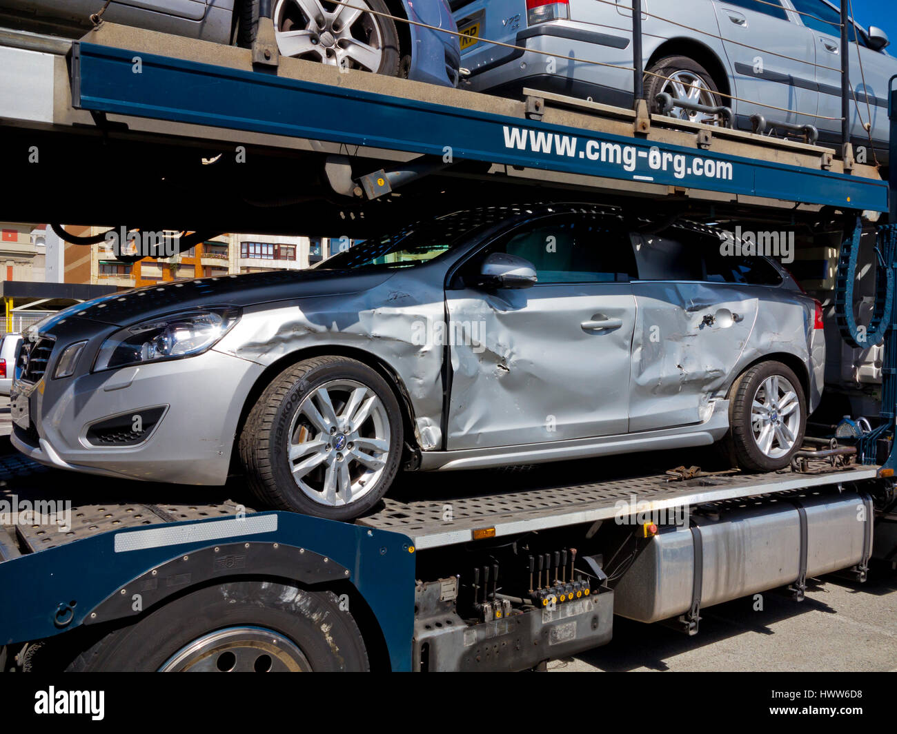 Car transporter loaded with accident damaged cars Stock Photo ...
