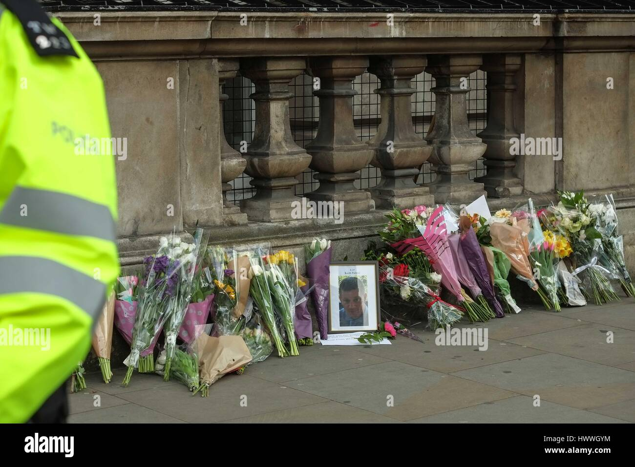 London, UK. 23rd March 2017. Flowers left by well wishers on Whitehall including a photograph of Pc Keith Palmer - Stock Image