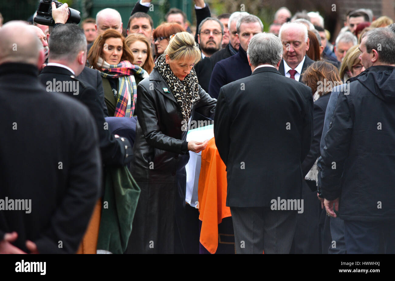 Derry, Northern Ireland. 23rd March, 2017. MEP Martina Anderson fixes an Irish flag to the coffin of Sinn Féins - Stock Image