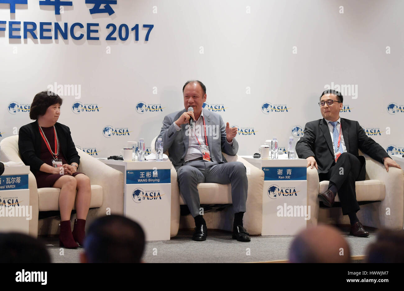 Boao, China's Hainan Province. 23rd Mar, 2017. Ken Xie (C), founder, president and CEO of U.S. network security - Stock Image