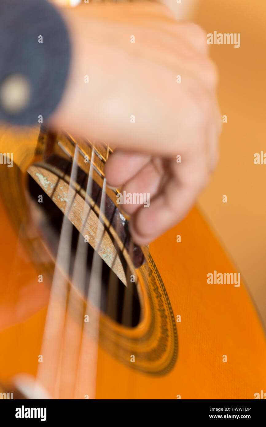 Classical guitar being played by young man. - Stock Image
