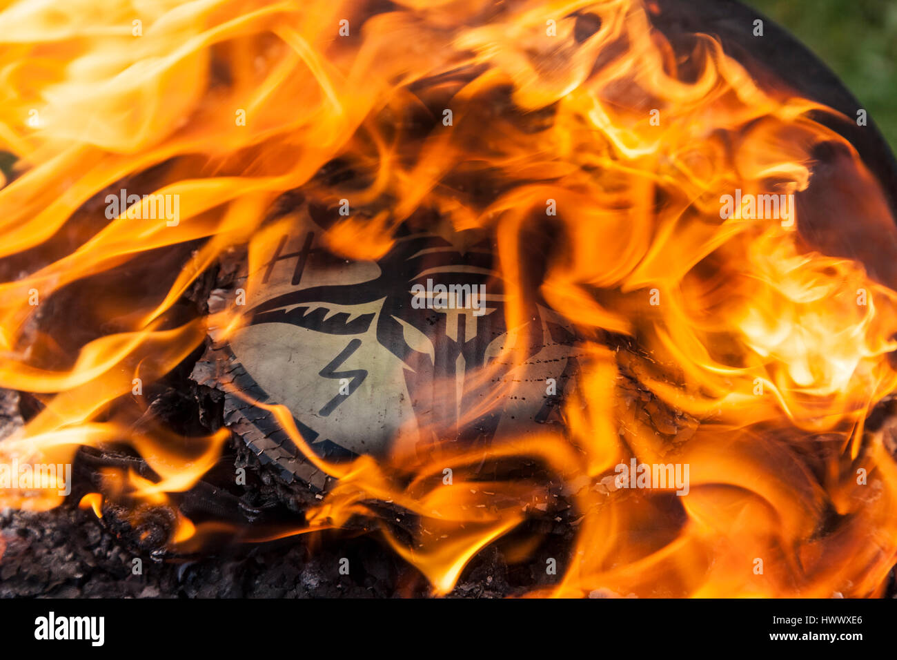 The mark of a company that no longer exists going up in flames. - Stock Image