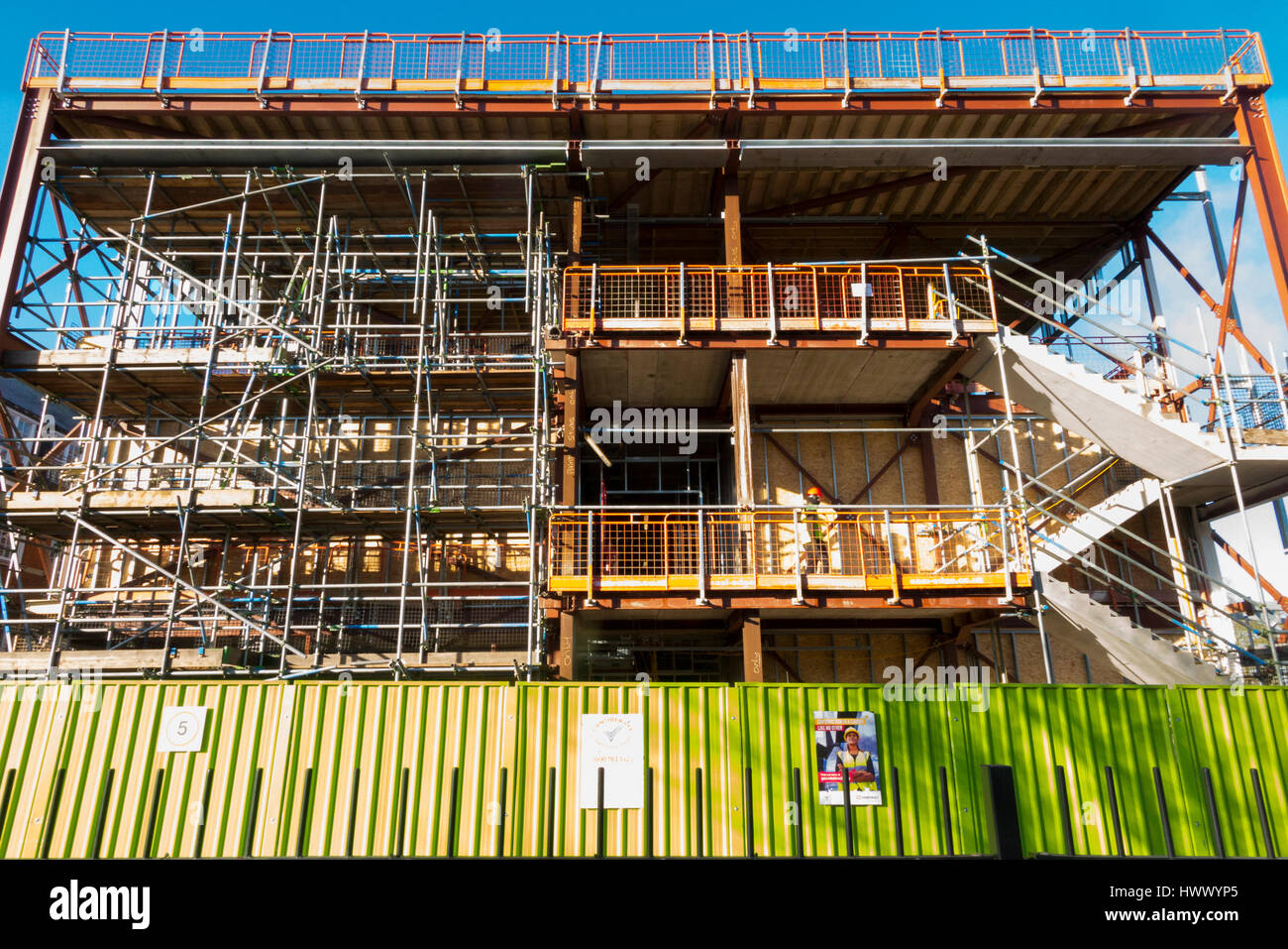 School extension / steel frame / framed building being built / assembled / constructed on a construction site with - Stock Image