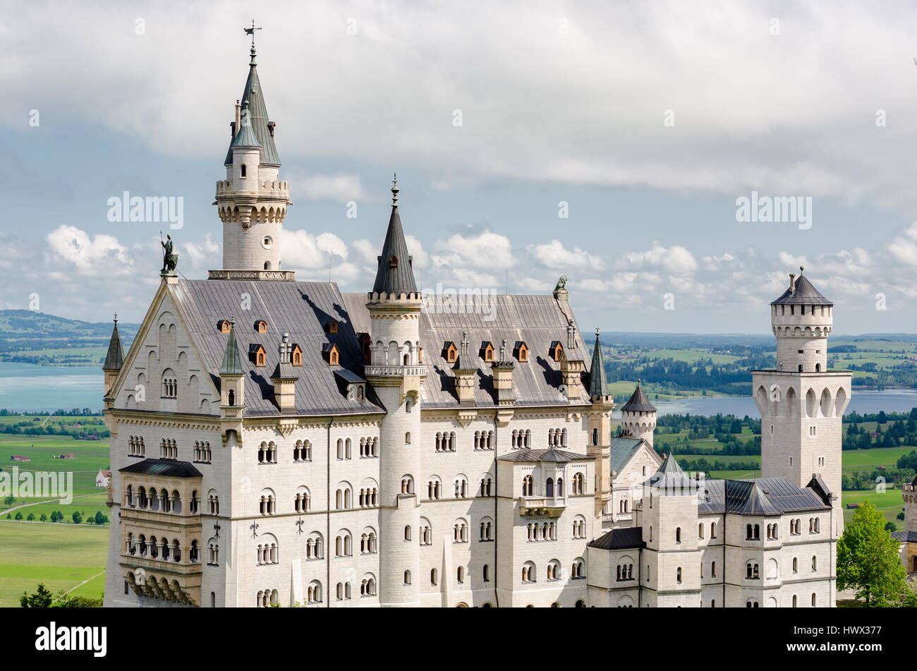 Neuschwanstein Castle is a nineteenth-century Romanesque Revival palace on a rugged hill near Fussen in southwest - Stock Image