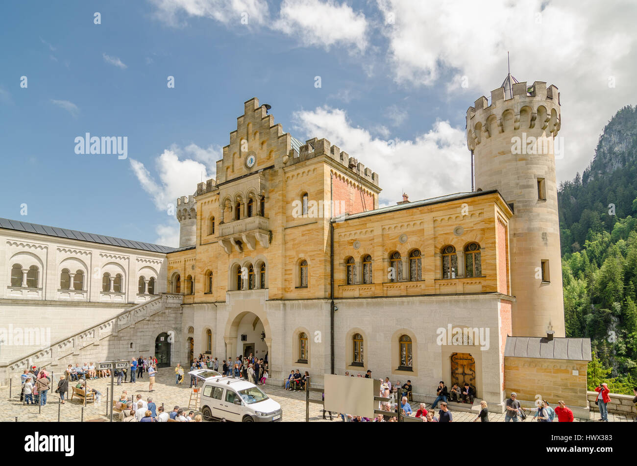 SCHWANGAU, GERMANY - JUNE 6, 2016: Neuschwanstein Castle is a nineteenth-century Romanesque Revival palace on a - Stock Image
